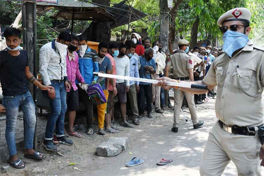 Police clash with crowds in Ahmedabad after stricter lockdown